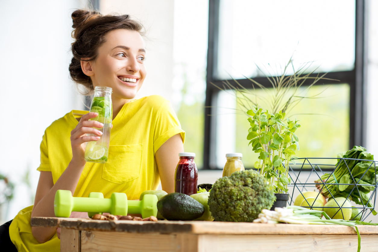 Woman drinking green smoothie.